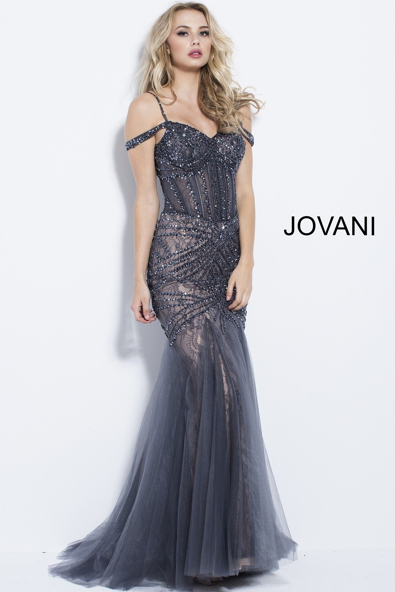 df58c8ce75514 Feel like a bombshell in Jovani 55876. This alluring mermaid gown features  a sheer corset bodice, with jeweled details along the corset boning, ...