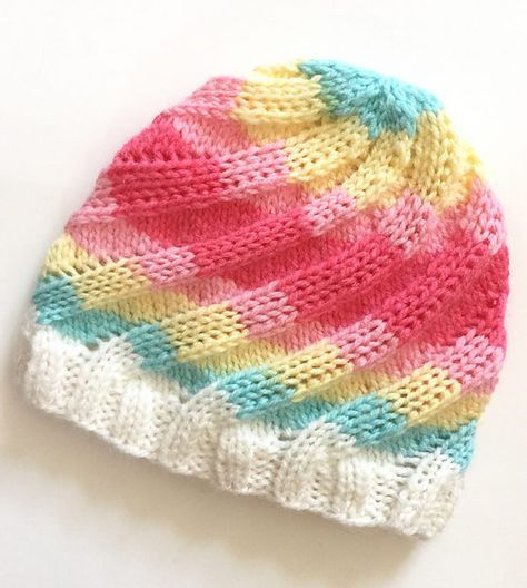 Free Knitting Pattern for Swirl Hat - Ribbed beanie knit in the round in  sizes from preemie baby to adult. Designed by Mandie Harrington. ac1f44c7fb03