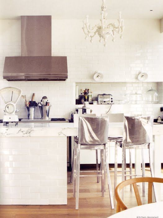This has always been a kitchen from Domino: The Book of Decorating that I have loved for its simple white and silver scheme.  I especially love the mass amount of subway tile, and the nook in the wall.