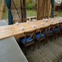 """The Arbor / Kerimov + Prishin Architects; """"suspended"""" wood table anchored on concrete"""