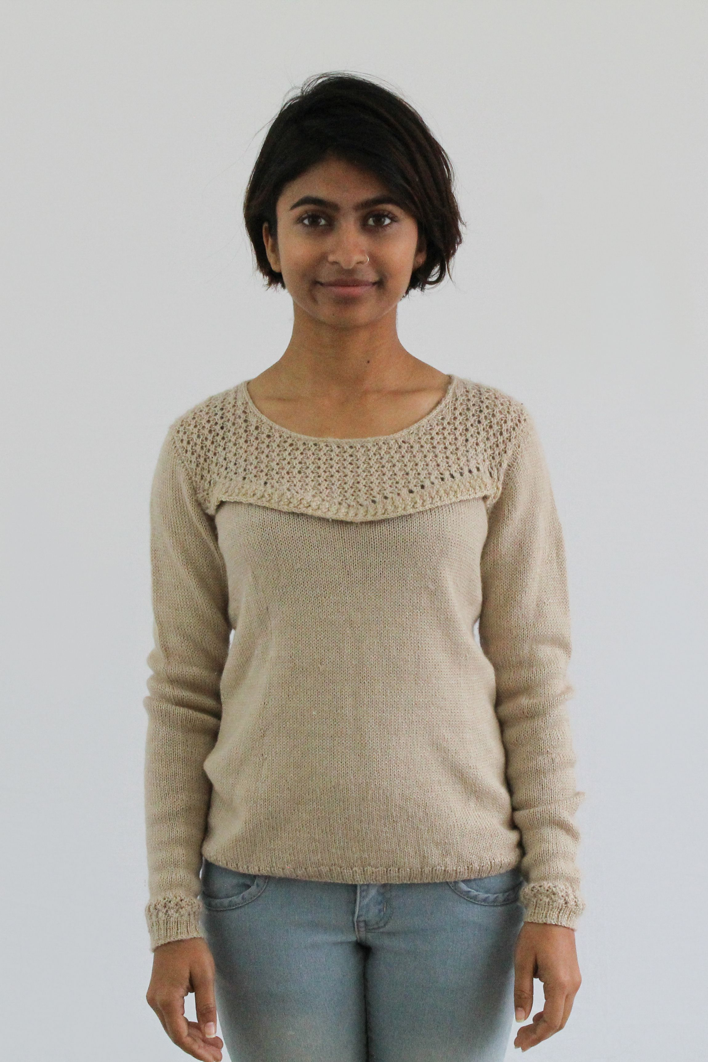 64172f1566e95c We adore the see-through panel around the neckline of this sweater. We have  the knitting pattern for  7.07!