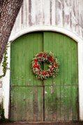 green door. natural wreath.