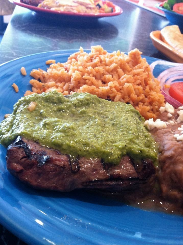 flat iron steak chimmichurri; a broiled steak topped with cilantro, parsley, garlic, oregano and jalapeno sauce. served with refried beans and jicama coleslaw with a side of tortillas.