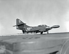 The exchange pilot from the Royal Canadian Navy lands his Grumman F9F-5 Panther aboard the aircraft carrier USS Oriskany off the coast of Korea on November 15, 1952.