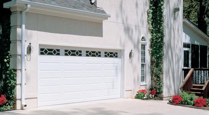 Traditional Long Panel With Waterford Windows In White Garage Door Styles Garage Doors Garage Door Types