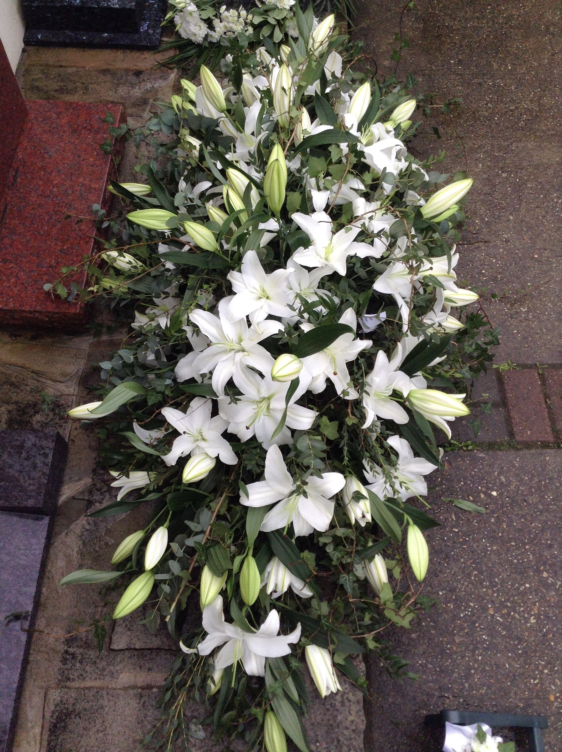 Funeral Flowers. white lily coffin spray, 6ft long coffin