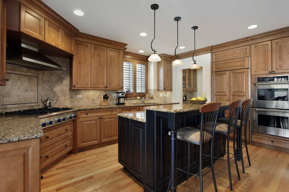 Charmant 39 Fabulous Eat In Custom Kitchen Designs   Enclosed Custom Kitchen Design.  Main Kitchen Cabinets In Natural Wood. Kitchen Island Is Black With Granite  Top.