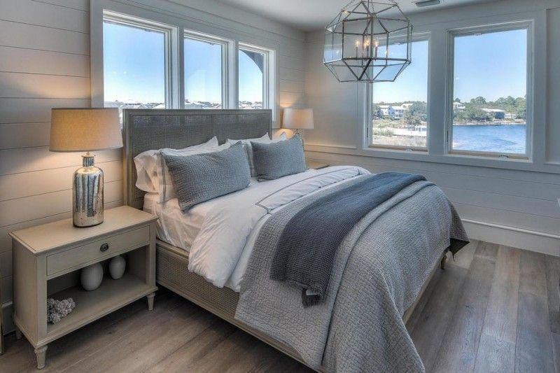 Bedroom With Soft Blue Grey Wall Grey Bedding Wood Flooring