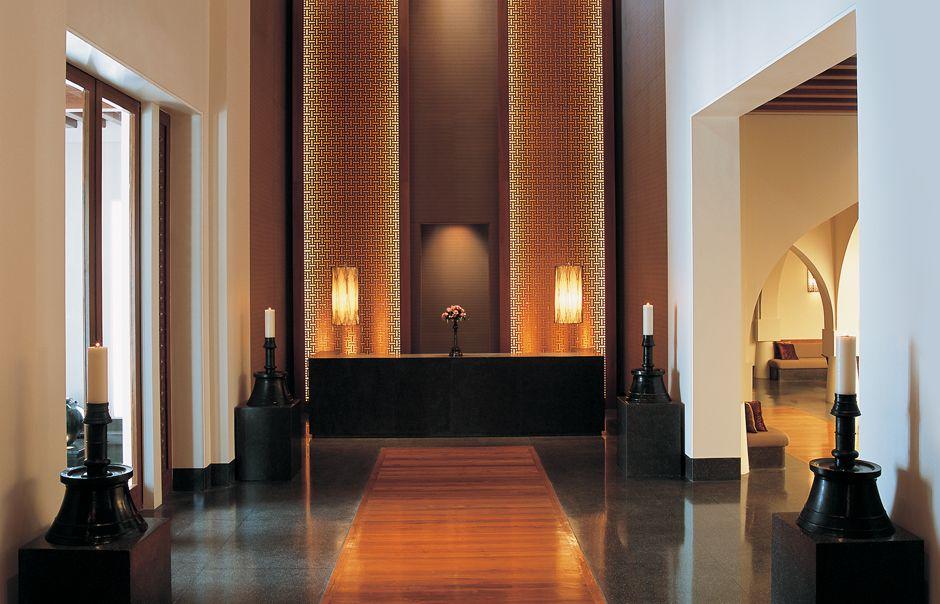 Entryway inspiration dark wood mashrabiya with soft for Designhotel oman