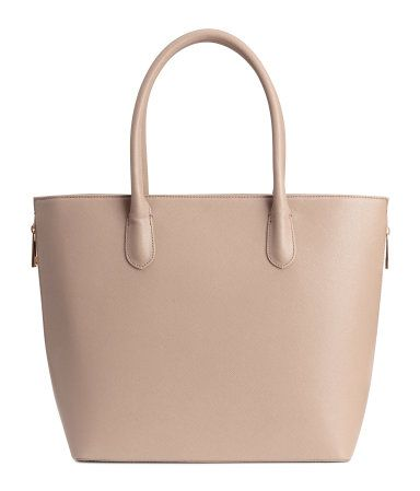 Handbag in grained imitation leather with double handles. Zip at top, zips at sides to expand bag, and three inner compartments, one with zip. Lined. Size 12 1/2 x 12 1/2 in.