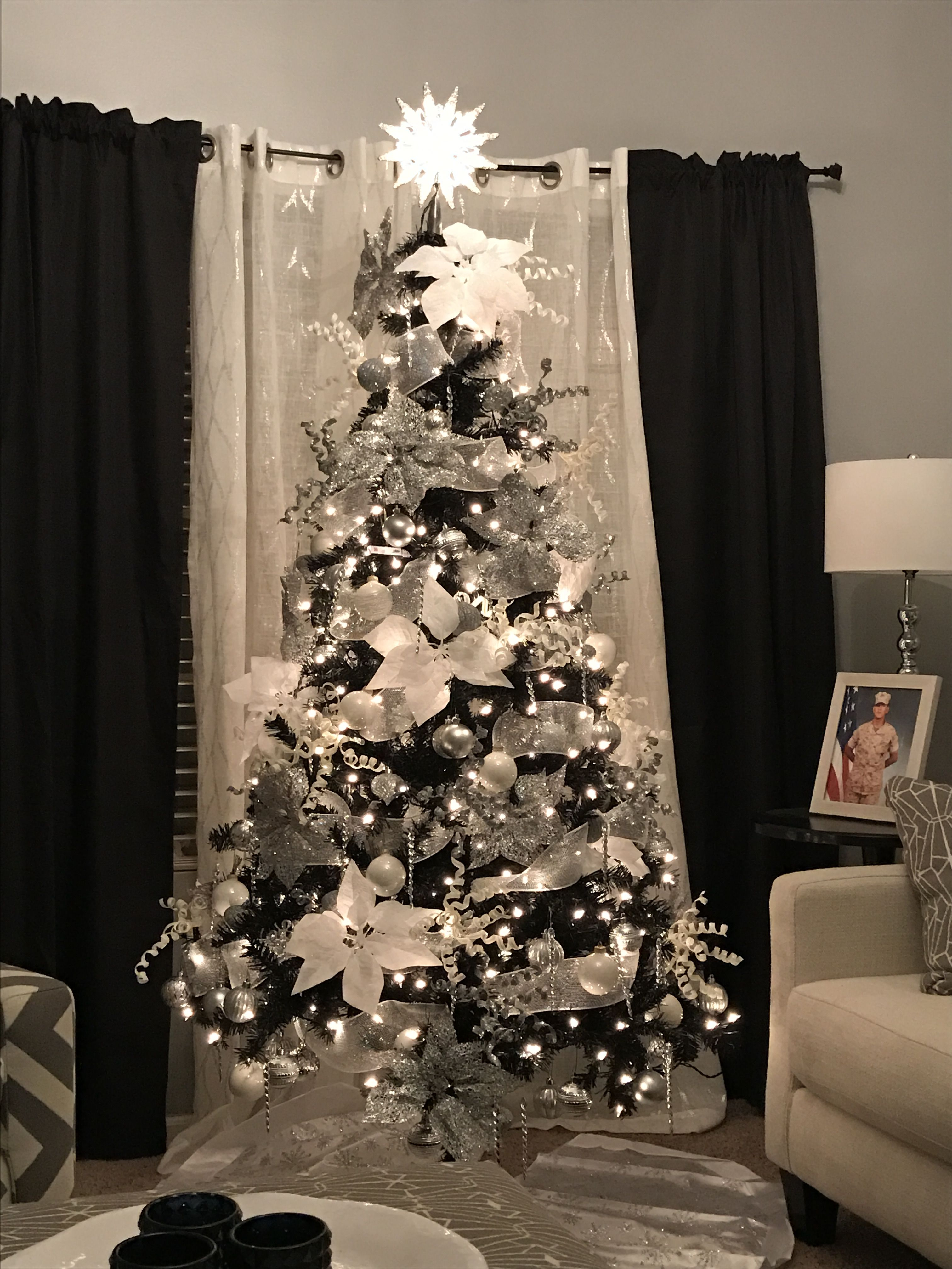 black christmas tree with silver and white decorations decorated by donna munoz - Black And White Christmas Tree Decorations