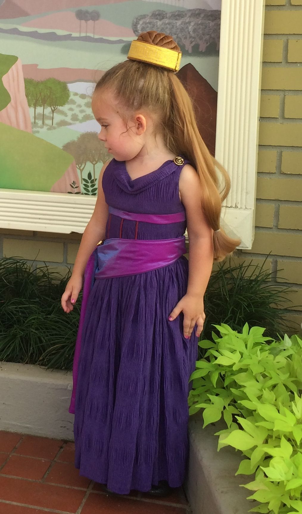 Lane cosplayed as Megara around the Magic Kingdom today. It was a ...