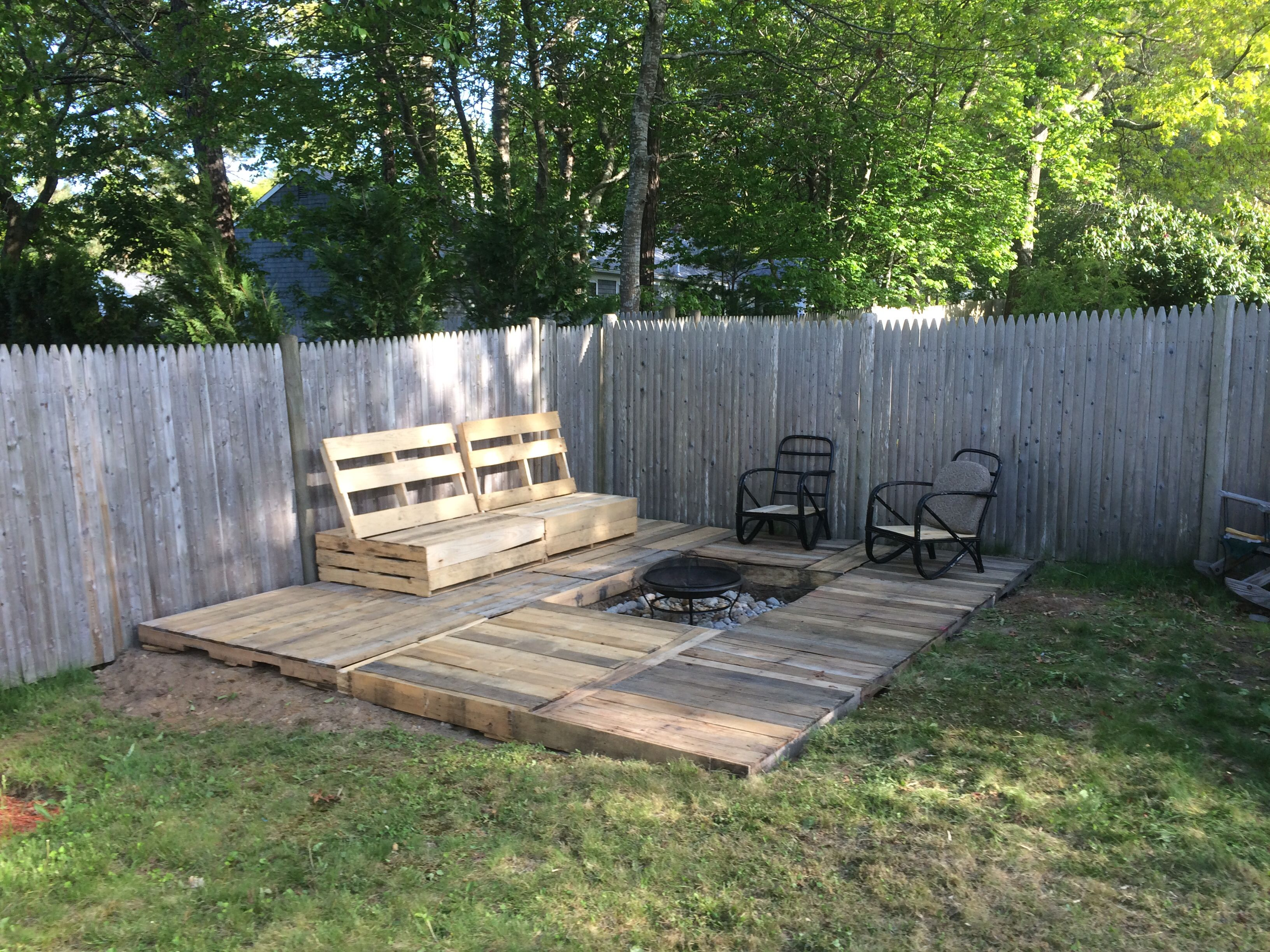 A pallet deck and pallet bench with a fire pit this took me about a