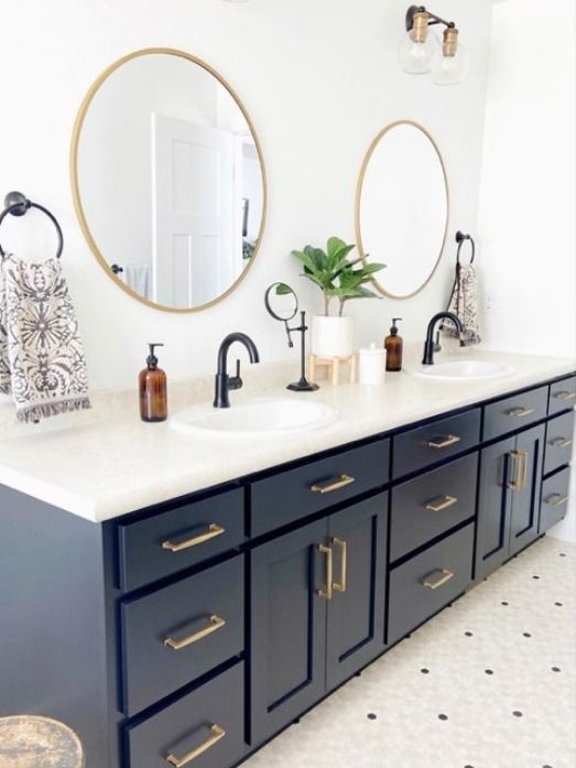 Photo of Farmhouse Inspired Bathroom Design with Dark Cabinets & Light Counters Illuminated by Vintage Lights