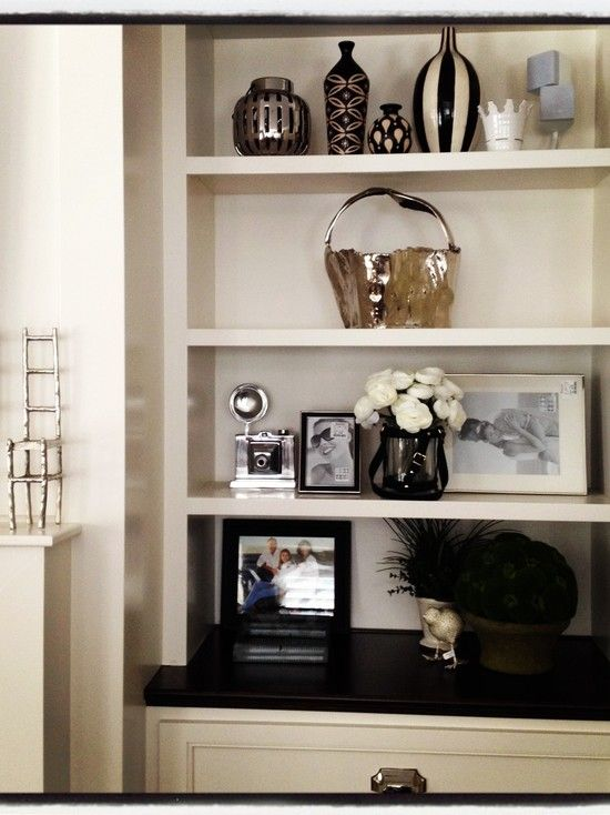Love this idea. Shelves with lower drawers on either side of fireplace.