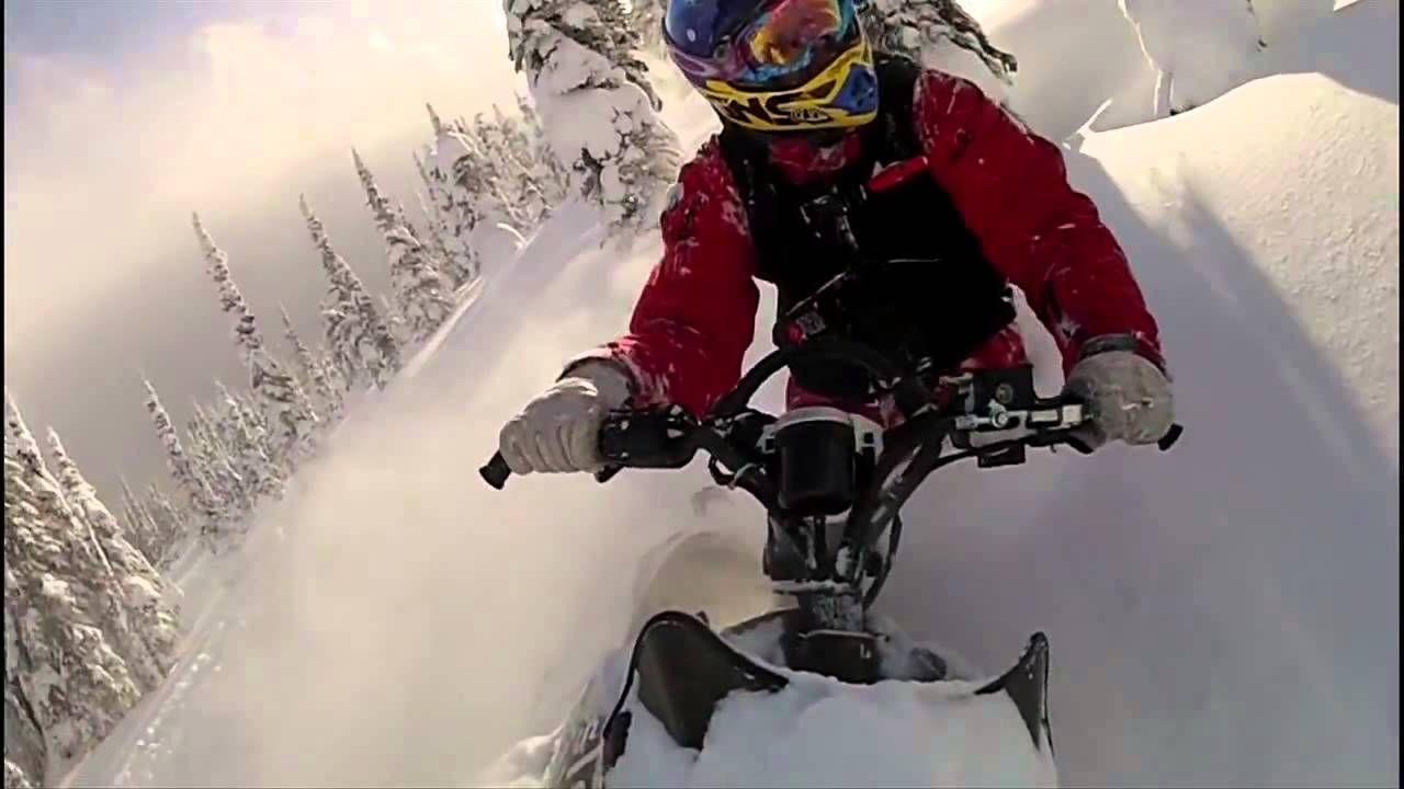 Snowmobiling In Deep Powder