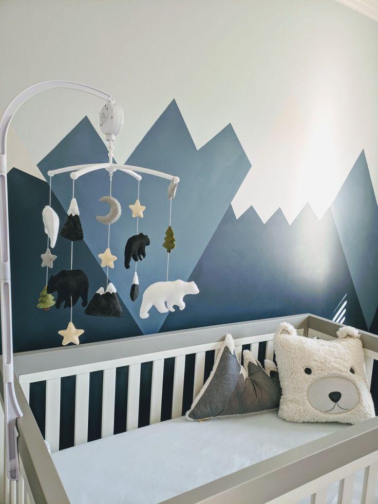 Inspiration for an adventure themed baby boy nursery with mountains and bears and cool shades of gray and blue. #nurserydecor #nurseryideas #babynursery #boynursery