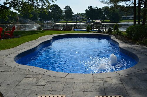 7 Pool Extras That Won T Break The Budget Pool Renovation Inground Pool Construction Pool Cost