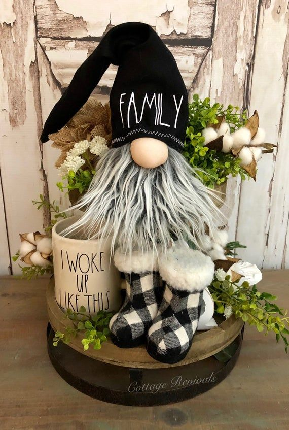 """Adorable inspired gnome with a black hat that says FAMILY. ⚠️ THIS IS A GNOME HEAD ONLY. Made to sit on a shelf/ledge. Current production time is 3 weeks. MEASURES APPROX (*please note these measurements are all approximates… These are handmade items and may vary within 1/2 - 1"""") 14"""" tall from #christmasgnomes"""