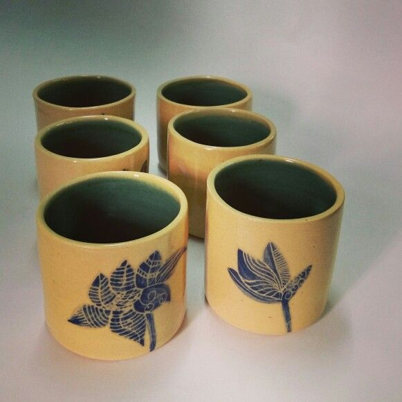 """Ceramic Tumblers"" They are perfect for a glass of water to a large glass of winner beer...Each one of these Tumblers were thrown on a Potters wheel, trimmed to perfection, decorate with sgraffito style in different slips. Microwave, Dishwasher and food safe!"