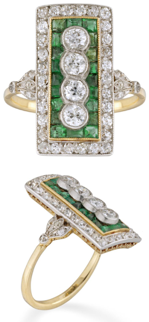 Edwardian emerald and diamond plaque ring, circa 1910. This beauty is millegrain rubover-set vertically with four old brilliant-cut diamonds weighing approximately a total of 0.60 carats. The four diamonds are surrounded by a calibre-cut emerald cluster set in yellow gold, within a old brilliant-cut diamond surround. The design is further embellished by a yellow gold scrolled mount and beautiful, delicate diamond-set leaf-adorned shoulders. Via Diamonds in the Library.