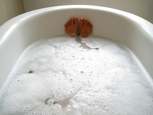 Once a week for 20 minutes, sit in a hot bath that contains a handful of Epsom salts, 10 drops of lavender essential oil, and a half cup of baking soda. This combo draws out toxins, lowers stress-related hormones, and balances your pH levels. :)