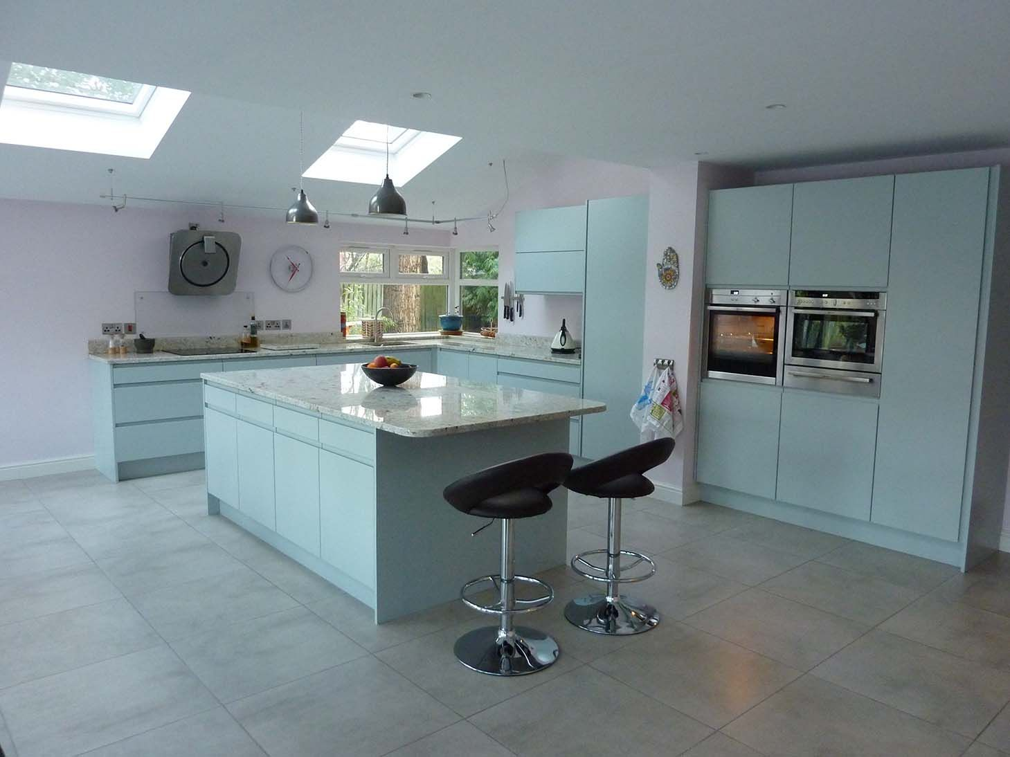 Handleless kitchen in duck egg blue with granite worktops ...