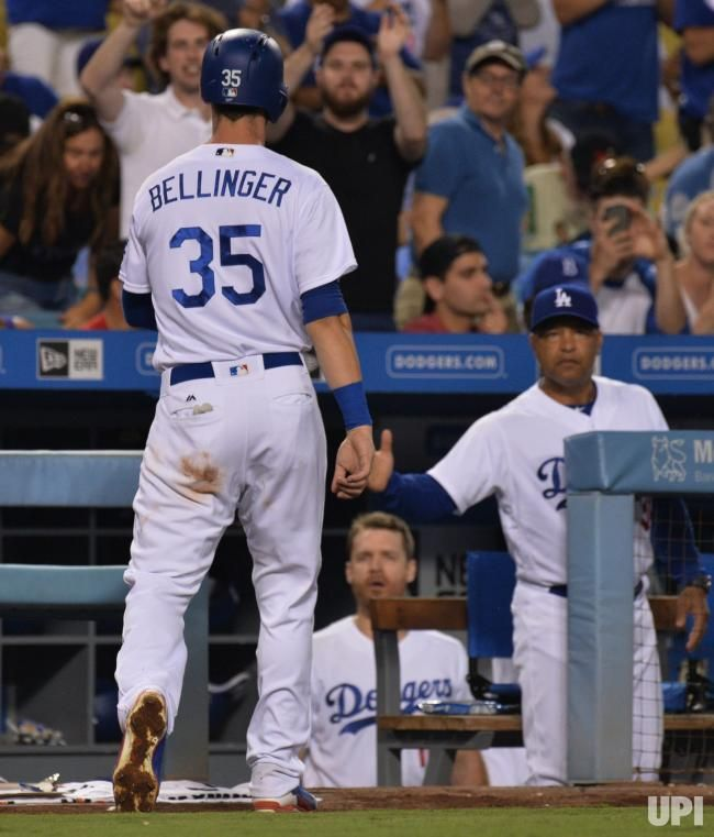 Los Angeles Dodgers Cody Bellinger Is Welcomed Back To The Dugout As Manager Dave Roberts Extends A Hand After Scoring On A Single By Dodgers Dugout Padres
