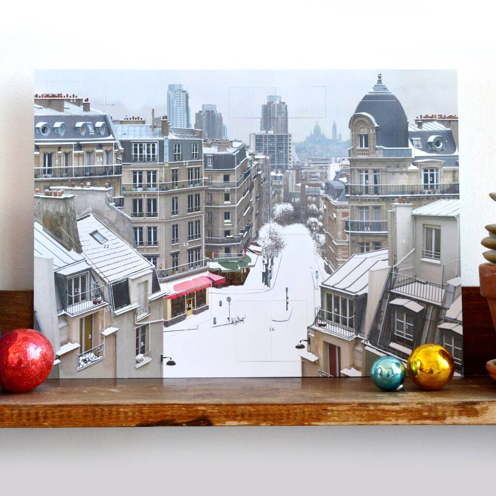 A contemporary advent calendar with all the traditional magic of Christmas. This is an advent calendar like no other. On the outside, it appears to be a silent, snowy Paris December day with the snow covered Parisian rooftops, cafes and streets. But the wintery scene hides a contemporary Christmas narrative. Open up the building facades, lift up a roof and open the windows to find magical, festive interiors and happenings. Mounted on card, measuring 40cm x 29cm, it comes in a cellophane bag and