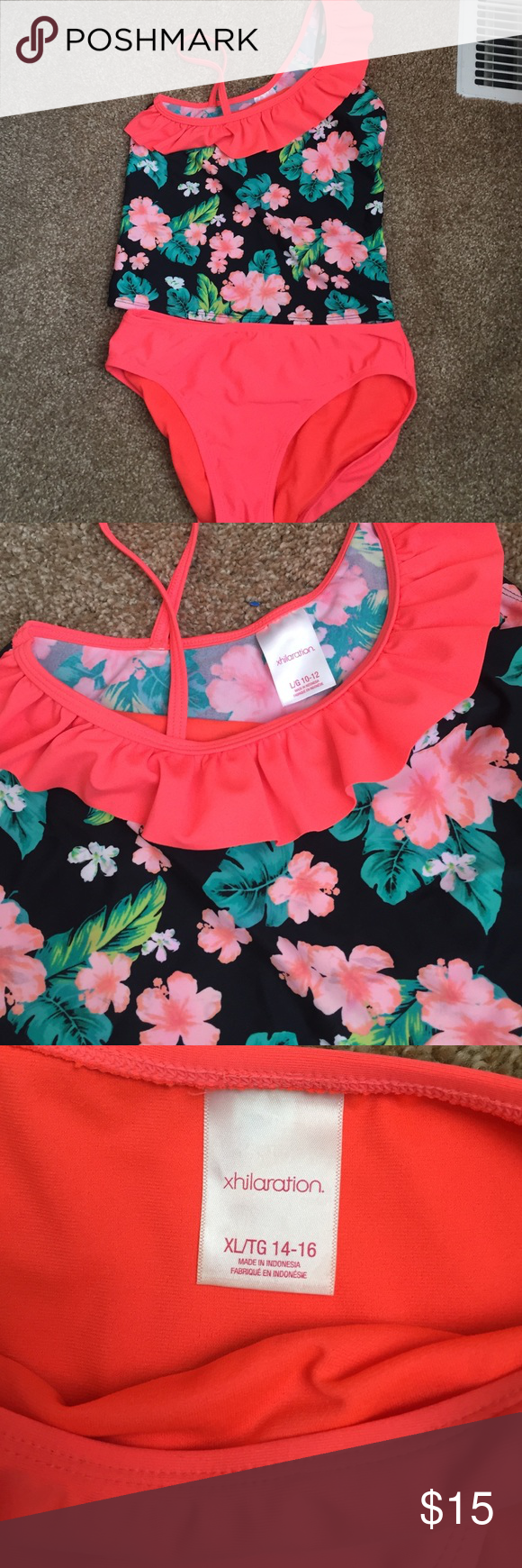 Xhilaration kids tankini Has been worn once but barely any signs of wear (only a little bit of scuffing on bottoms). The top is a size large(10/12) and the bottoms are an xl(14/16). They could definitely be purchased separately!! Xhilaration Swim