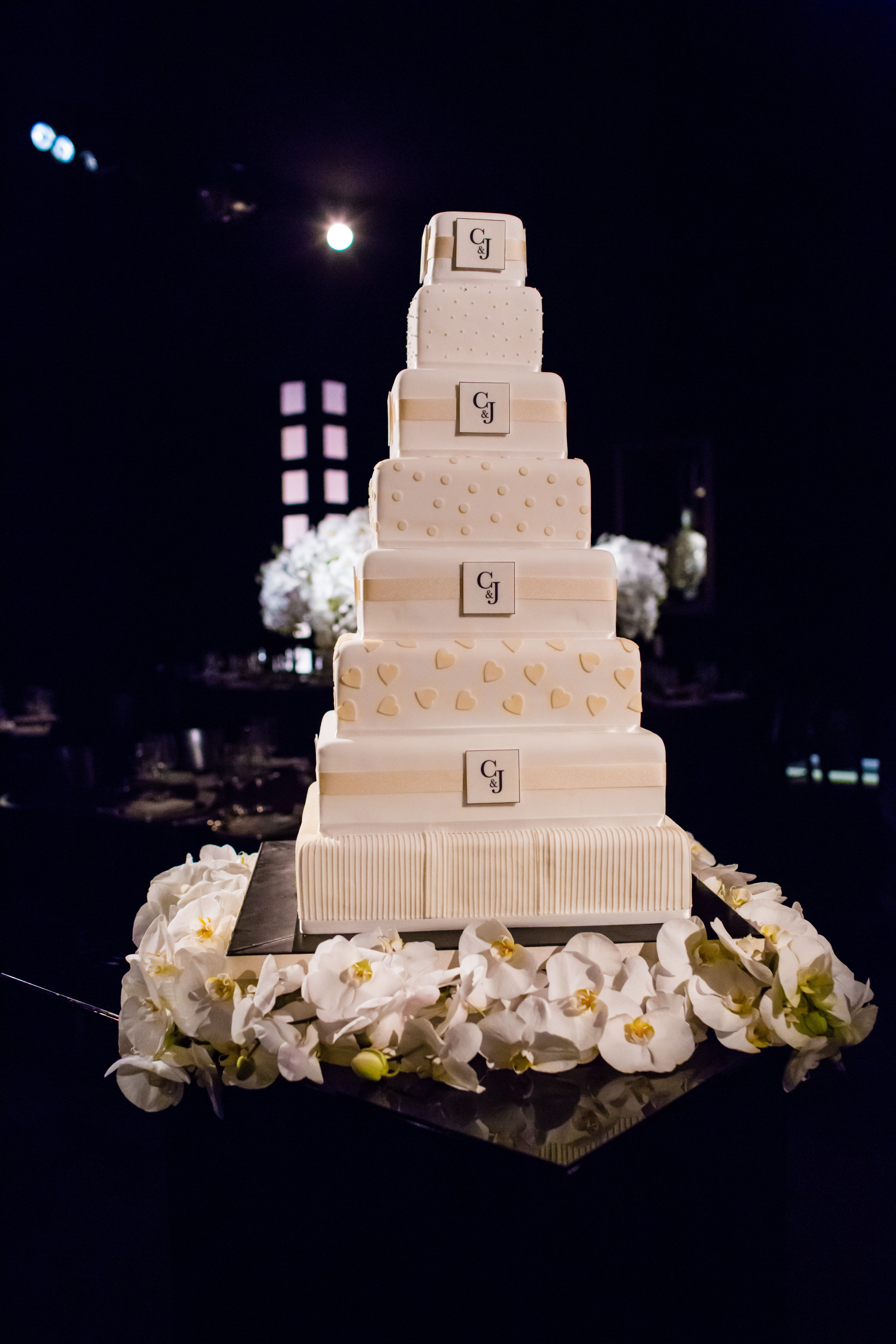 Dramatic 8 tier wedding cake surrounded by orchids | Fabulous ...