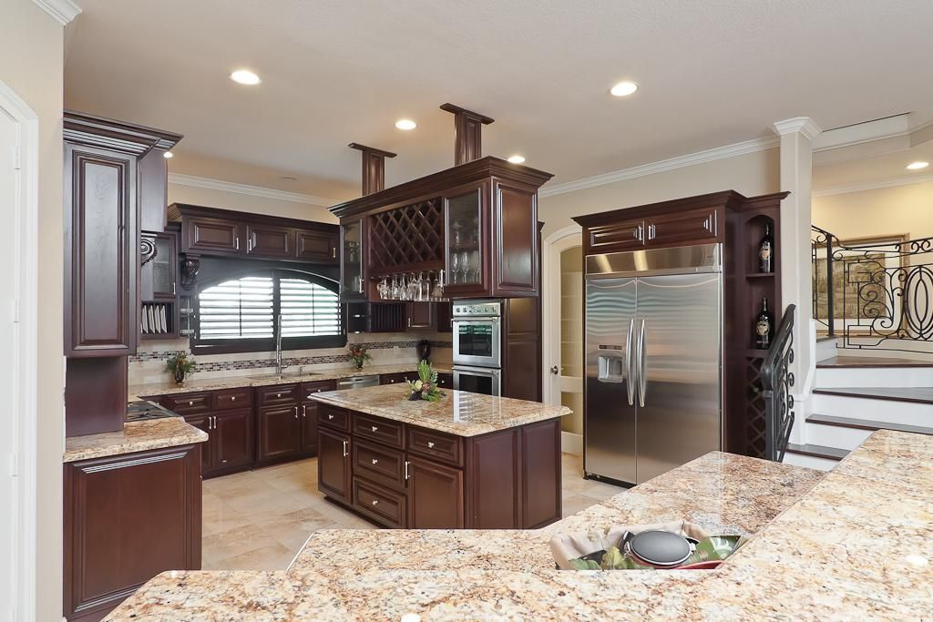 Traditional Kitchen With Ceramic Tile Limestone Tile Glass Panel