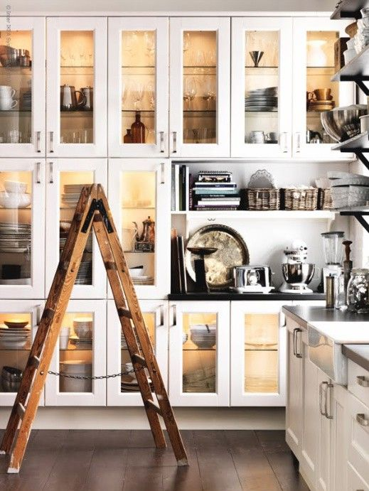 To have all this kitchen storage would be a dream.  Hello cabinet love  To have the white kitchenaid would be a dream.  I do have a better vintage ladder though so not all is lost!