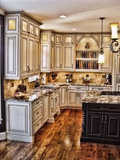 Absolutely love the wood floors here; and the distressed appearance u0026 color  of cabinets.
