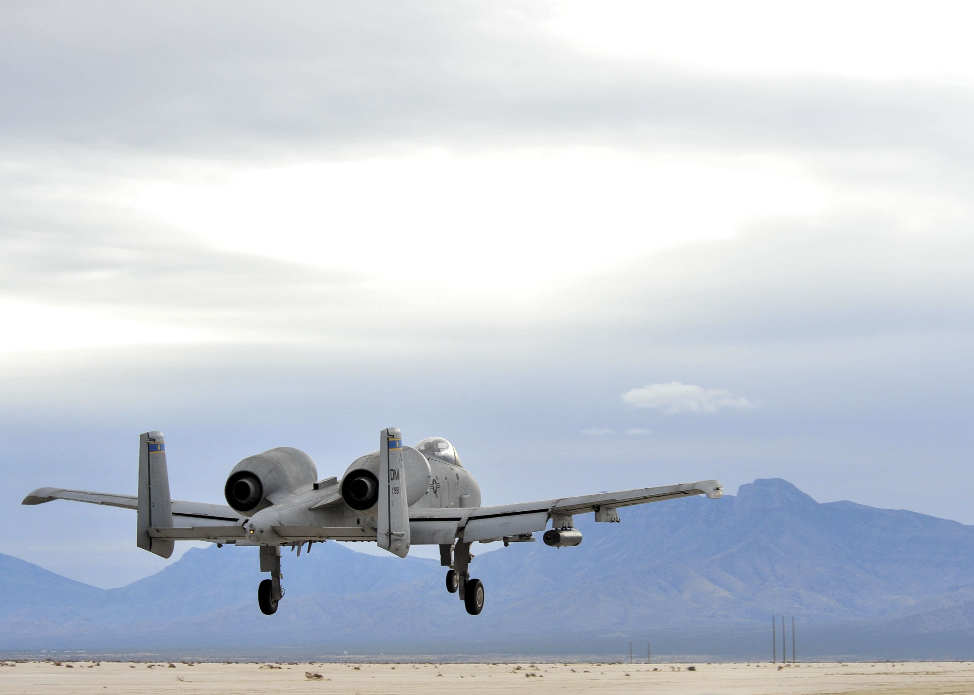 An A-10C Thunderbolt II from the 354th Fighter Squadron performs a low pass during training at White Sands Missile Range, N.M., Dec. 4, 2014. Pilots 354th FS pilots traveled to the missile range to conduct instructor pilot training for austere landing on unimproved surfaces. (U.S. Air Force photo by Airman 1st Class Chris Massey/Released)