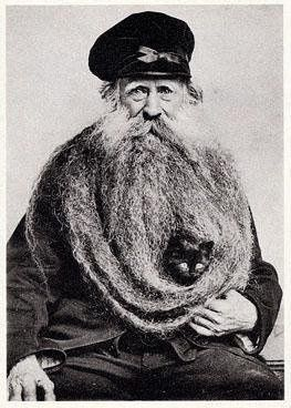 the ole cat in the beard!   such a classic    sea captain pose!   ( ...seriously, what's with the cats? )