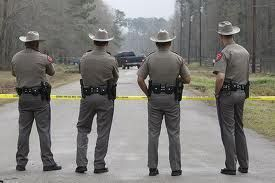 State Highway Patrol Troopers - the Troopers' headwear is unique in that cowboy hats are worn with the duty uniform.