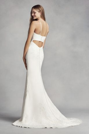 f5e9a68fcdee This modern White by Vera Wang crepe sheath gown is embellished with  symmetrical hand-beaded lace appliques and features an on-trend halter  neckline.