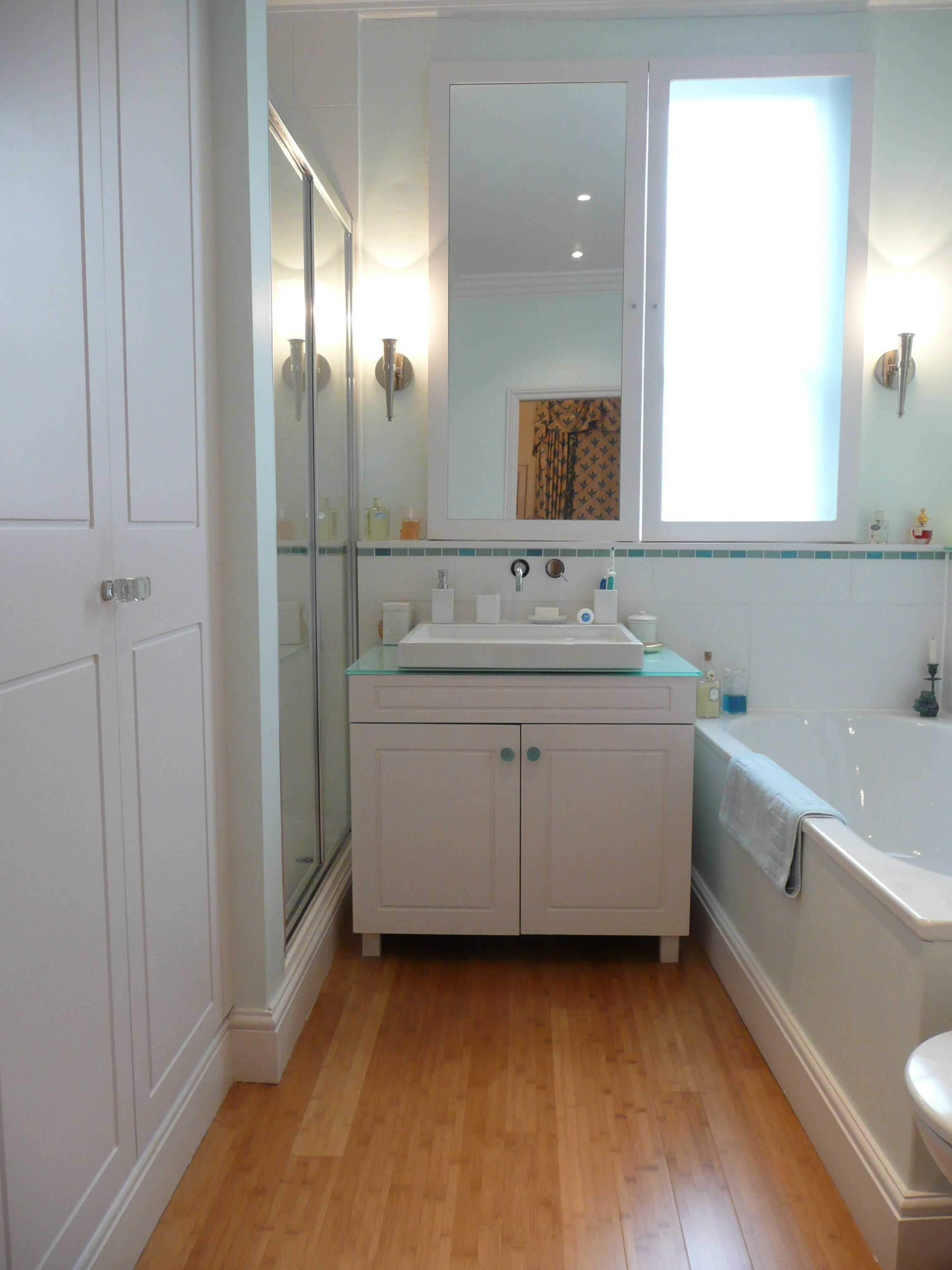 bamboo flooring in bathroom, i think i like that color too ...