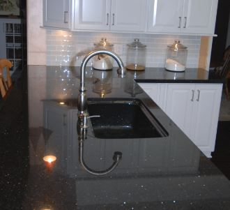 Kohler Vinnata Faucet In Brushed Nickel With Kohler Cape Dory Sink In Black  In Black Galaxy Granite.