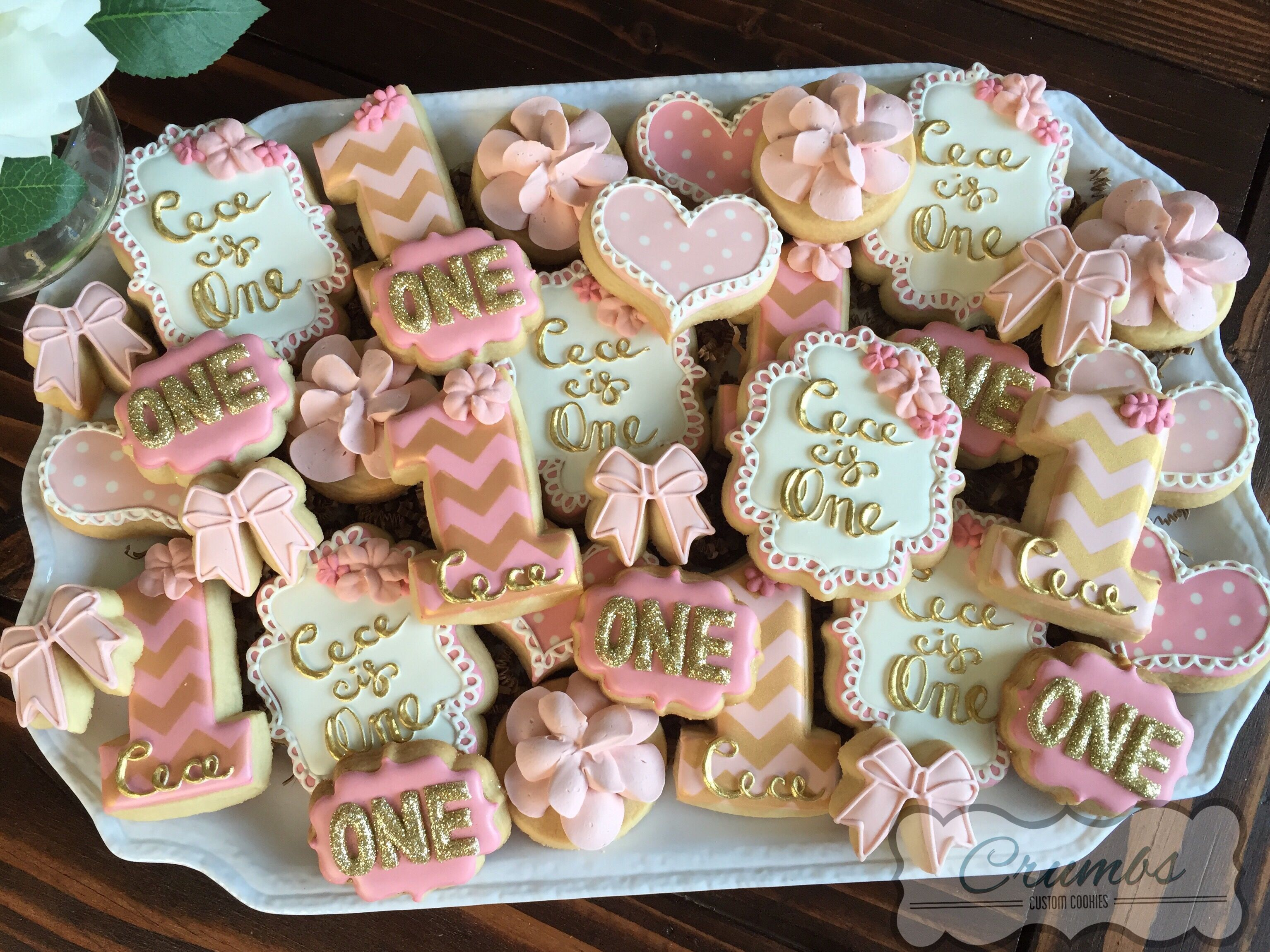 Pink and gold first birthday cookies by Crumbs CrumbsCustomCookies