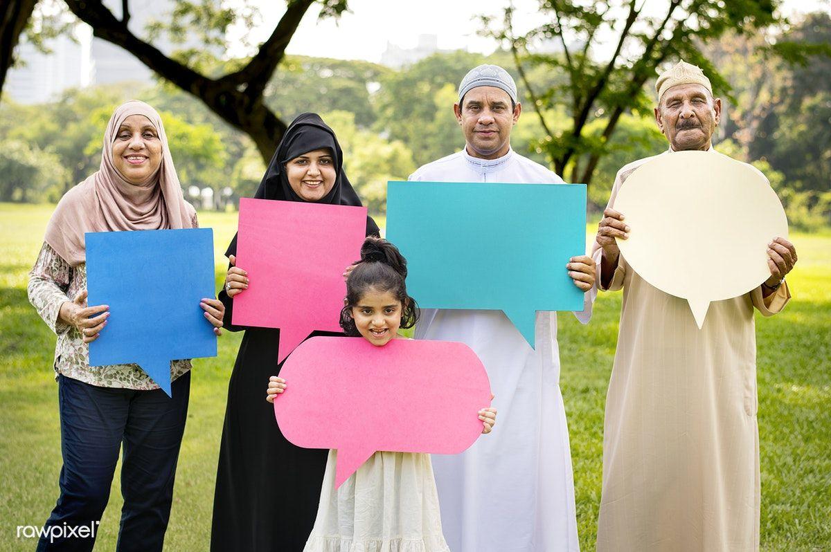 Download premium photo of muslim family holding up speech
