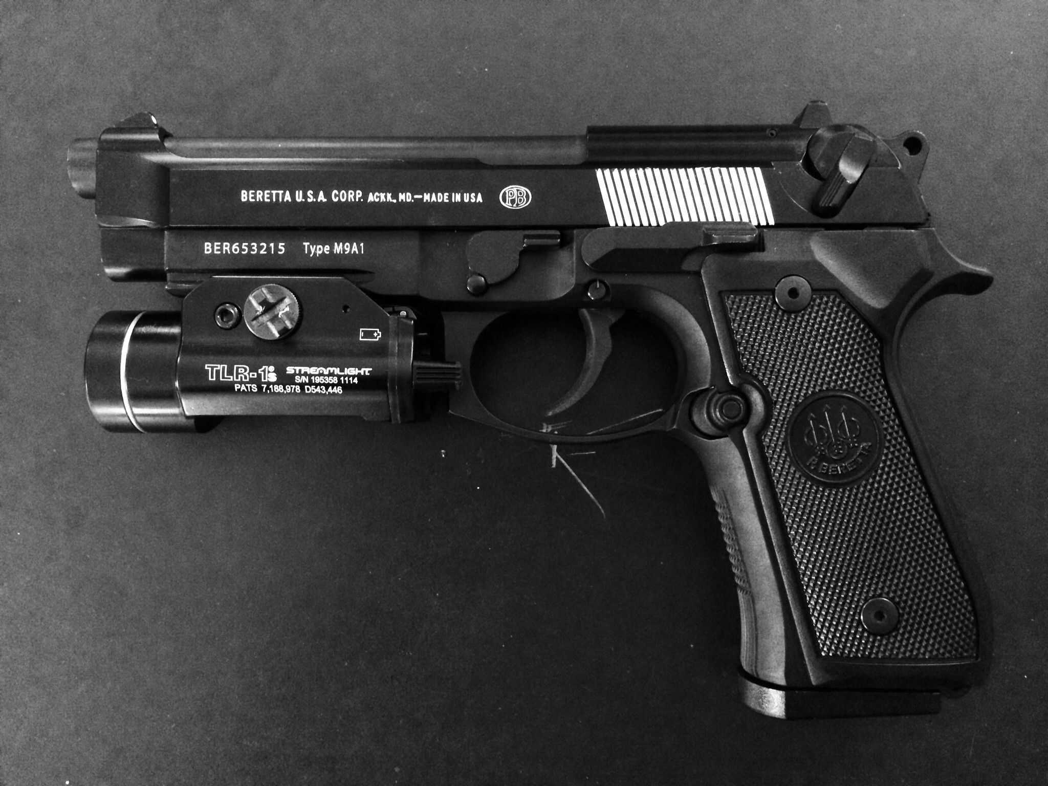 Beretta M9A1 with TLR-1S weapon light Loading that magazine is a ...