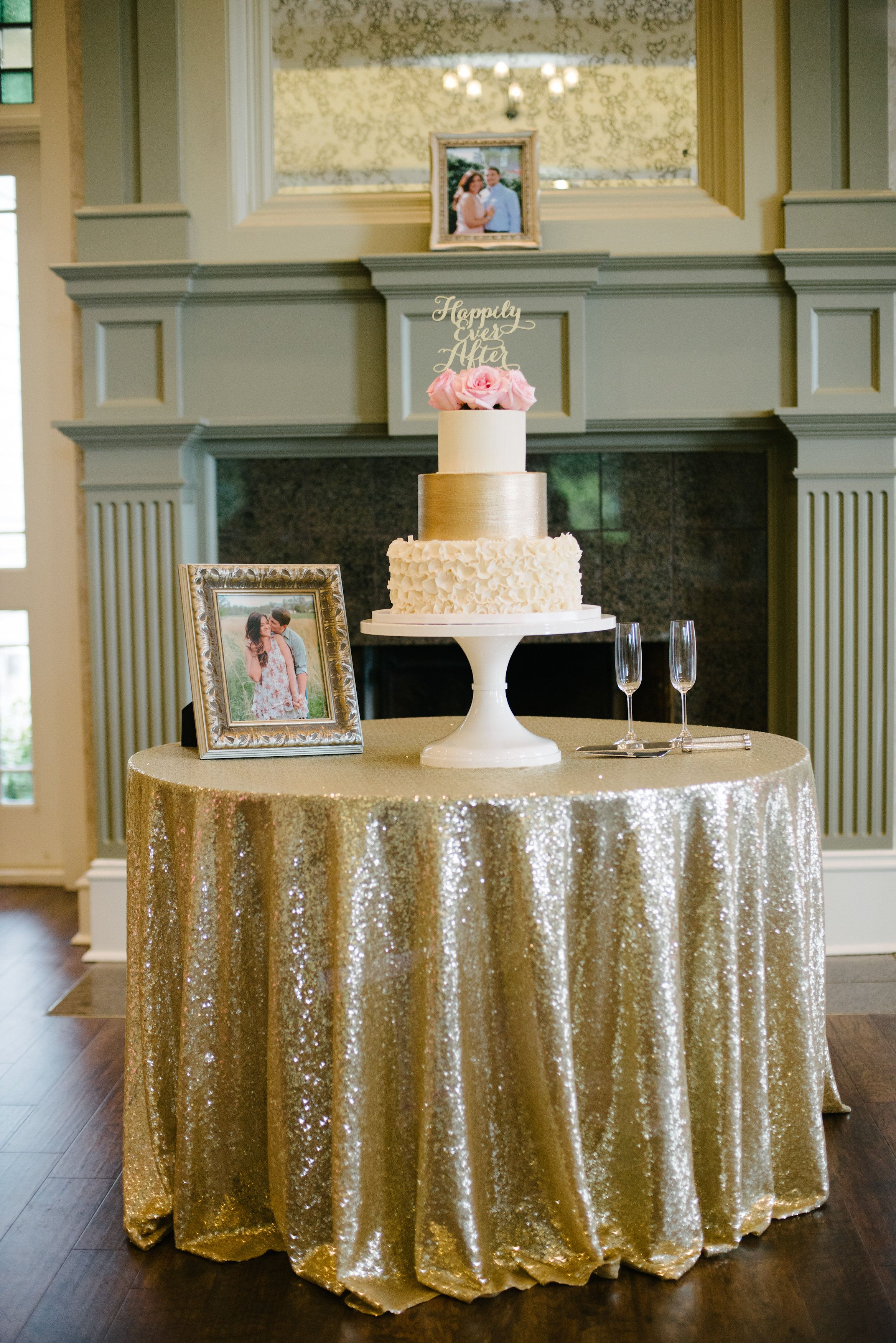 Beautiful Wedding Cake Display On A Sequined Table Cloth Burritt