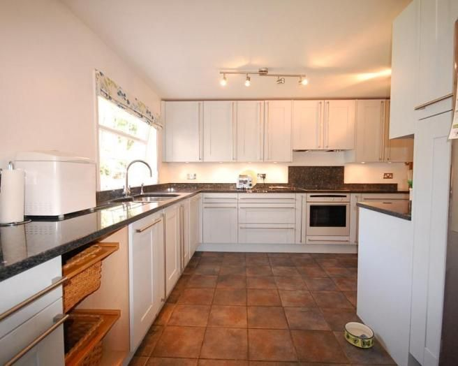 Photo Of Beige Brown White Kitchen With Floor Tiles Flooring Tiles Dog Bowl