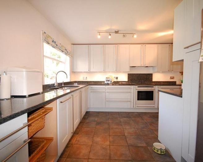 Best Photo Of Beige Brown White Kitchen With Floor Tiles 400 x 300
