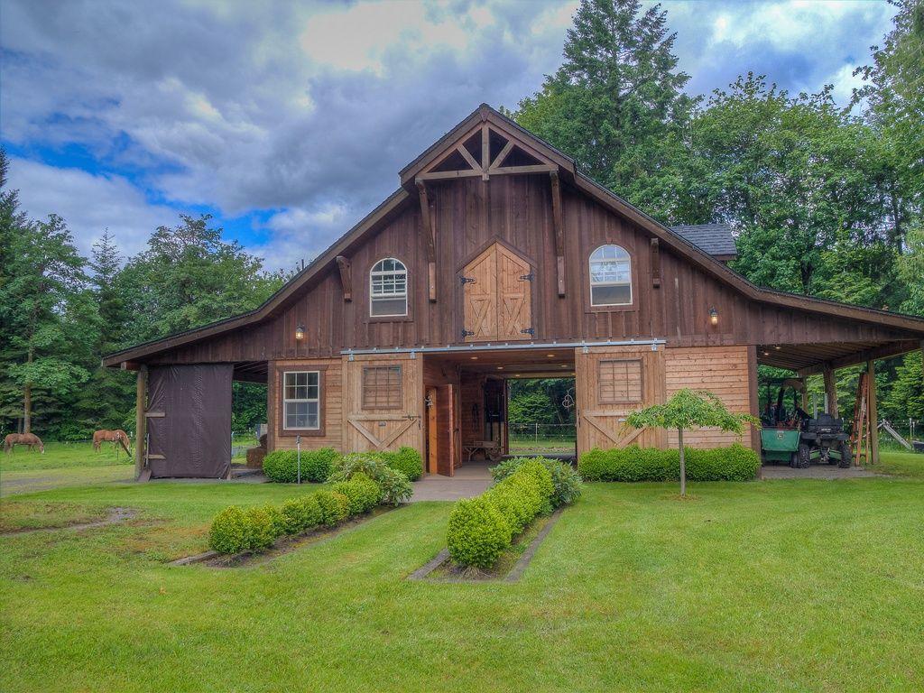 Country garage with sliding barn doors sod solutions geo turfgrass custom 4 stall barn two tone exterior siding
