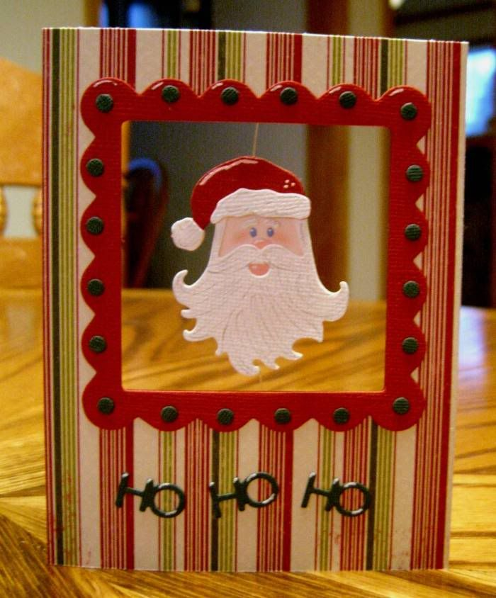 Christmas card with hanging Santa in a framed window