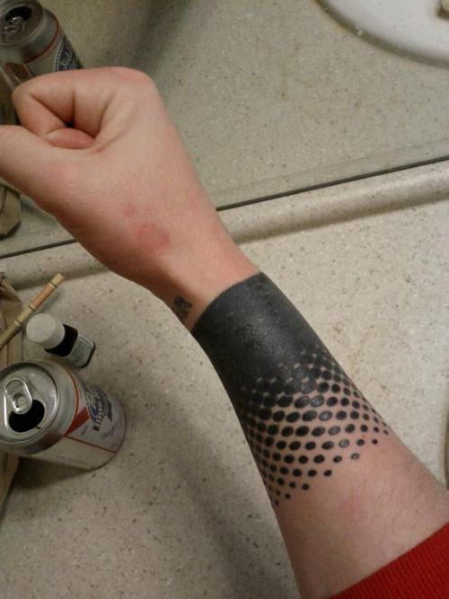 Heavy Black Tattoo Cover Up: [A Partial Sleeve Tattoo On Someone's Lower Arm—a Thick