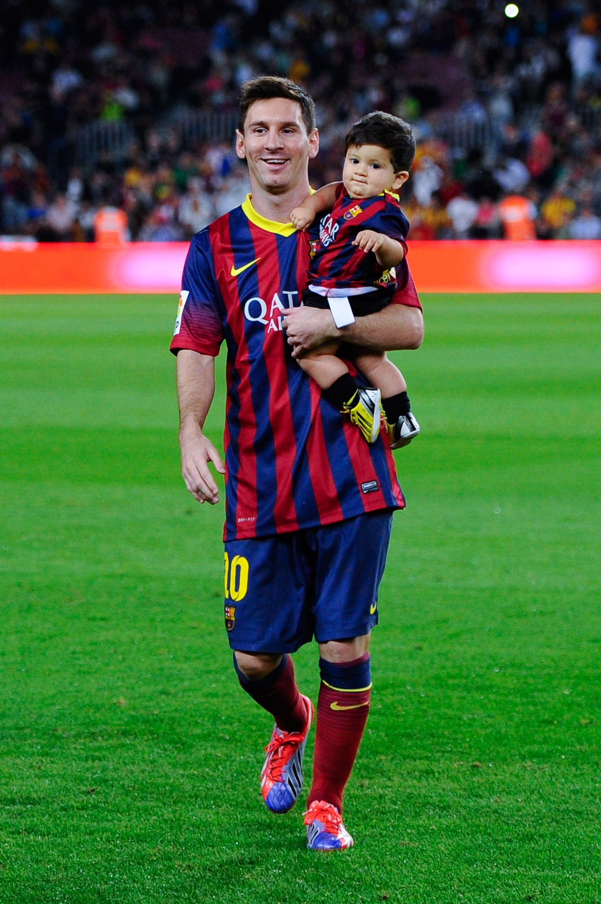 Lionel Messi of FC Barcelona with his son Thiago walk out the pitch prior  to the La Liga match between FC Barcelona and Real Sociedad de Futbol at ...